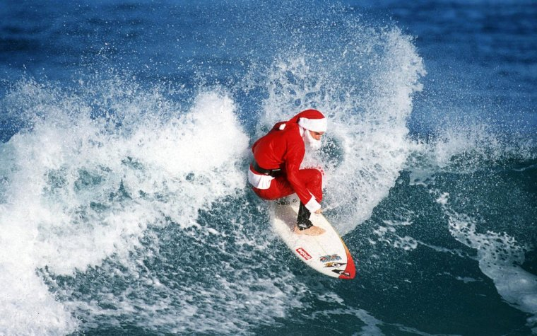z-wallpaper-christmas-surfing-santa-claus.jpg
