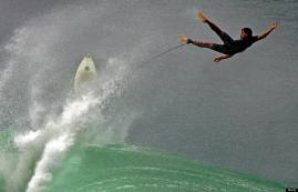 Rio de Janeiro, BRAZIL: A Brazilian surfer fails to ride a wave during undertow, 18 April 2006, at Leblon beach in Rio de Janeiro, Brazil. Weather forecasts have announced since 2 days ago a strong cold mass covering the southeastern of Brazil provocating heavy swells and a fall of 10 centigrades in the temperature. Small and medium boats were warned to stay in the harbors. AFP PHOTO ANTONIO SCORZA (Photo credit should read ANTONIO SCORZA/AFP/Getty Images)
